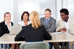 Female woman sitting at interview Stock Photo