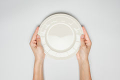Female(woman) two hands hold a dish stock photo