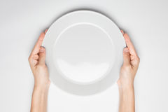 Female(woman) two hands hold(support) a white dish(plate) isolat royalty free stock images