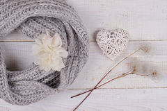 Female woman warm knit Scarf Neckwarmer Circle Cowl on white wooden rustic background. Shabby chic style. Cozy winter. Romantic fe Royalty Free Stock Photos
