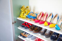 Female / women`s shoes and more shoes - wardrobe / cupboard / sh. Collection of women`s shoes on white background stock images