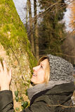 Female in the wood. Young attractive female embracing a tree Royalty Free Stock Photography
