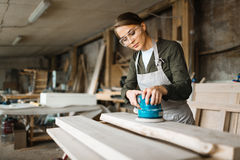 Female woodworker wrapped up in work Stock Photography