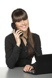 Female at work place talking on phone Royalty Free Stock Photo