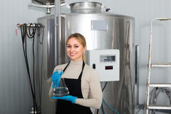 Female worker on beer brewery Royalty Free Stock Photos