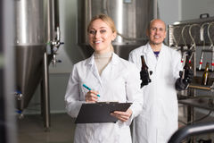 Female worker on beer brewery stock images