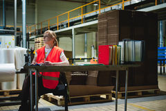 Female worker on beer factory. portrait woman in robe, standing on background line Food production, Inspection management control royalty free stock photo