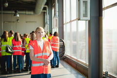 Female worker on beer factory. portrait woman in robe, standing on background line Food production, Inspection management control. Blonde woman in overalls, on royalty free stock photography