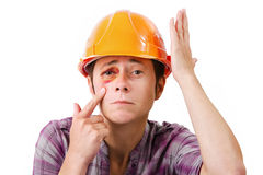 Female worker with a black eye in the helmet Stock Images