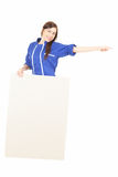 Female worker with blank sign showing something Stock Images