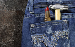 Female worker blue jeans with rhinestone decoration Stock Photo