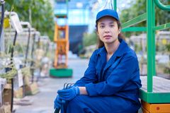 Female Worker on Break in Plantation. Portrait of tired young woman taking break while working on modern vegetable plantation, copy space royalty free stock photography
