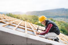 Young woman worker on the construction site. stock photo