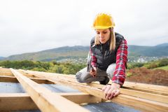 Young woman worker on the construction site. Royalty Free Stock Photo