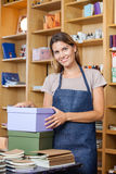 Female Worker With Cardboard Boxes In Store Stock Image