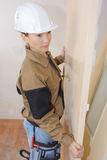 Female worker carrying board royalty free stock photos