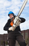 Female worker with chainsaw Royalty Free Stock Image