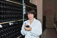Female worker checking secondary fermentation Stock Image