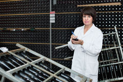 Female worker checking secondary fermentation stock images
