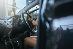 Female worker cleaning car inside dashboard,using waxy applying polish in car. Female worker cleaning car ine dashboard,using waxy applying polish in the car Royalty Free Stock Photo