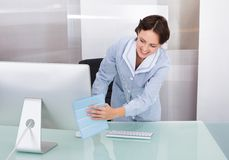 Female worker cleaning office Royalty Free Stock Photo