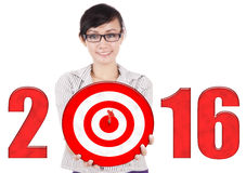 Female worker with dartboard and numbers 2016 Royalty Free Stock Images