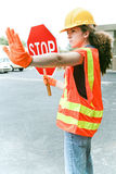 Female Worker Directs Traffic Royalty Free Stock Photography
