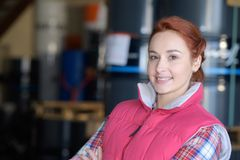 Female worker in distribution warehouse. Female stock image