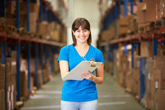 Female Worker In Distribution Warehouse. Looking to camera stock photography