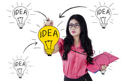 Female worker drawing idea concept Royalty Free Stock Photography