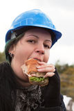 Female worker eating sandwich Royalty Free Stock Images