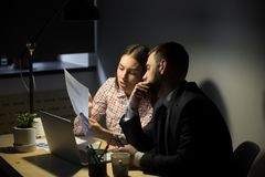 Female worker explaining graphs to male coworker Stock Images