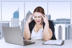 Female worker frustration with her job Stock Photo