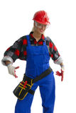 Female worker in gear. A female worker wearing overalls and protective gear, possibly for construction or building Royalty Free Stock Photos