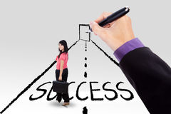 Female worker guided to success door Royalty Free Stock Photo