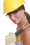 Female worker with hammer Stock Photo