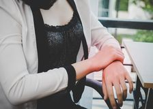 Female worker having office syndrome injury on her wrist carpal. Tunnel stock photo