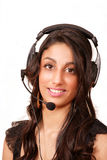 Female worker with headphone. Beautiful professional female with headphone or headset Royalty Free Stock Image