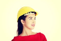 Female worker in helmet looking up. Royalty Free Stock Photography