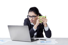 Female worker holding coffee in office Stock Image