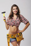 Female worker holding hammer Royalty Free Stock Images