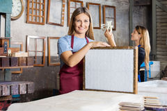 Female Worker Holding Mold With Paper In Factory Royalty Free Stock Image