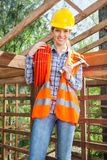 Female Worker Holding Pipe And Hammer At Site Royalty Free Stock Photo