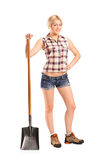 Female worker holding a shovel Royalty Free Stock Photos