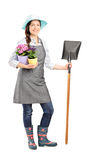 Female worker holding a shovel Royalty Free Stock Photo
