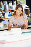 Female Worker Holding Spiral Book In Factory Royalty Free Stock Photography