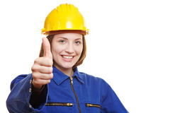 Female worker holding thumbs up Stock Images