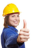 Female worker holding thumbs up Stock Photography