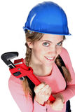 Female worker holding a wrench. Stock Photos