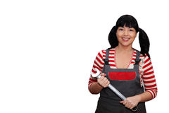 Female worker holding a wrench. Brunette woman with a wrench in his hand Stock Photo